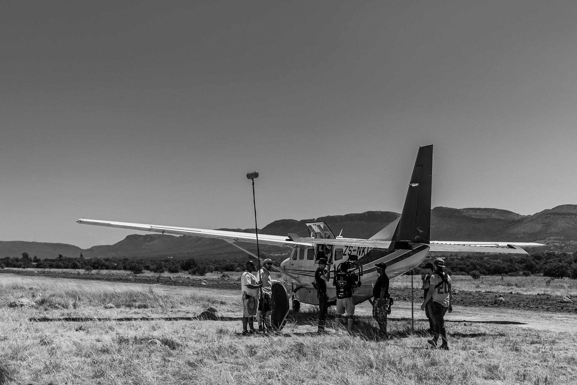 Shoot Day 06 of 22; Sc 18; Int / Ext. Bush runway in the Plane - Landing Strip: BTS.